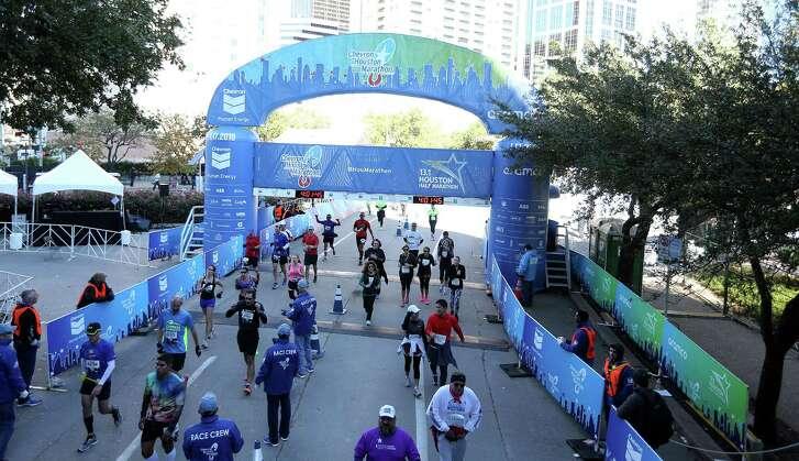 Full and half marathoners make their way across the finish line during the Houston Marathon on Sunday, Jan. 16, 2016.