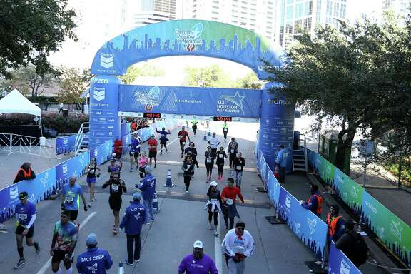 Full and half marathoners make their way across the finish line during the Houston Marathon on Sunday, Jan. 16, 2016.