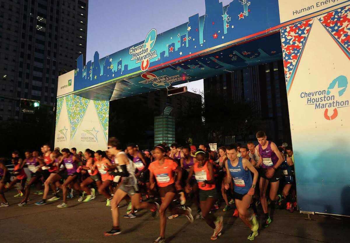 Runners take off from the starting line for the 42nd annual Houston Marathon on Sunday, Jan. 17, 2016, in Houston.