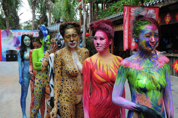 SANYA, CHINA - JANUARY 10:  (CHINA OUT) Women painted like animals pose at Songcheng Theme Park on January 10, 2016 in Sanya, Hainan Province of China. Over ten animal protectors did body paintings at Songcheng Theme Park to call for animal protection.