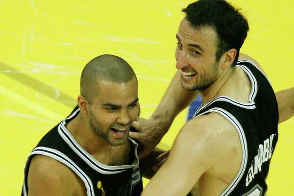 Manu Ginobili #20 and Tony Parker #9 of the San Antonio Spurs celebrate their 83-82 victory over the Cleveland Cavaliers to win Game Four of the NBA Finals on June 14, 2007 at the Quicken Loans Arena in Cleveland, Ohio. NOTE TO USER: User expressly acknowledges and agrees that, by downloading and or using this photograph, User is consenting to the terms and conditions of the Getty Images License Agreement. (Photo by Gregory Shamus/Getty Images)