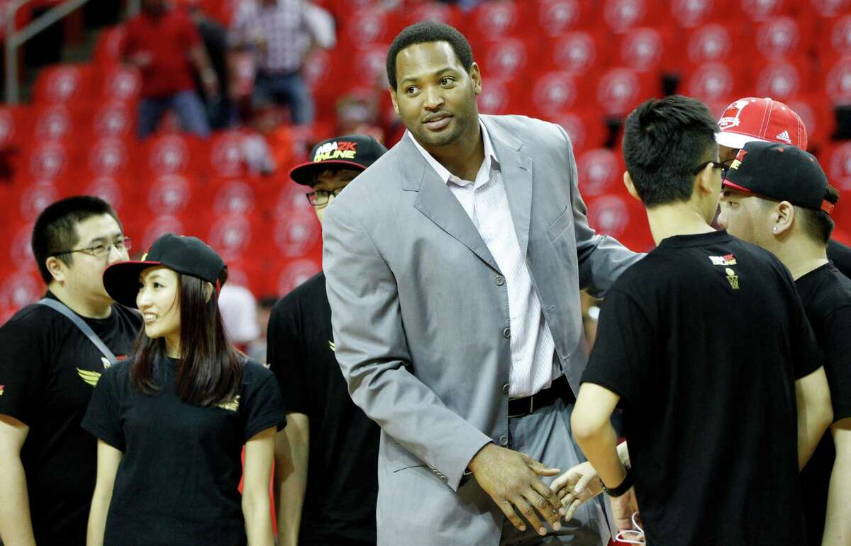 Former Houston Rockets player Robert Horry greets fans before Game 4 of the NBA Western Conference finals against the Golden State Warriors at Toyota Center onMay 25, 2015, in Houston.