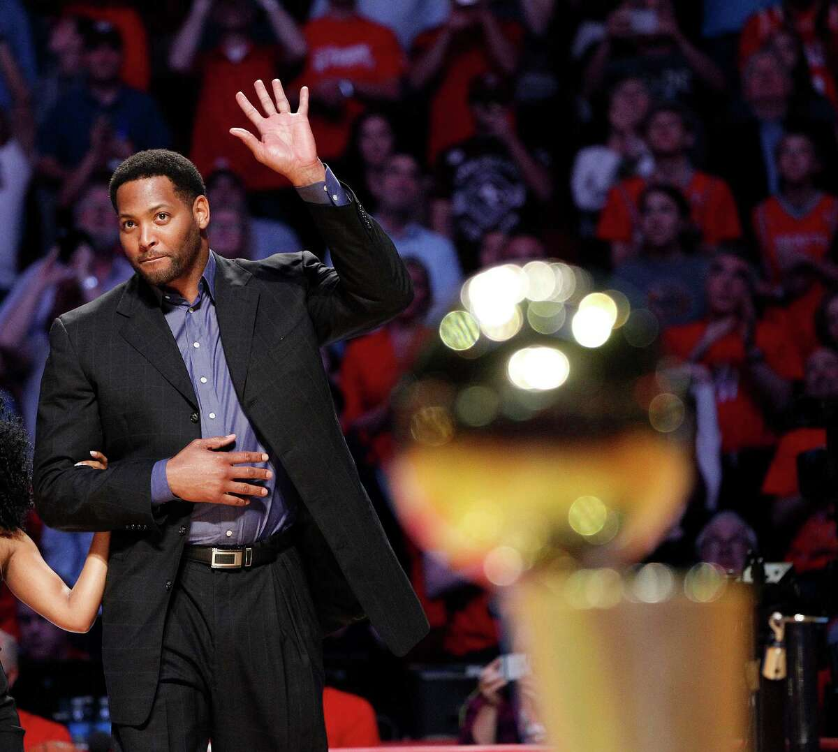 Former Houston Rockets Robert Horry was escorted to center court during the 20th Anniversary of the 1995 Houston Rockets championship during a halftime ceremony of an NBA game at Toyota Center on March 19, 2015, in Houston.