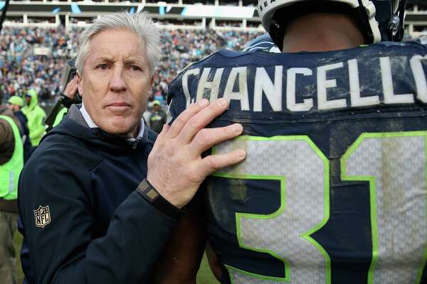 CHARLOTTE, NC - JANUARY 17:  Head coach Pete Carroll talks with  Kam Chancellor #31 of the Seattle Seahawks after losing to the Carolina Panthers 31-24 at the NFC Divisional Playoff Game at Bank of America Stadium on January 17, 2016 in Charlotte, North Carolina.