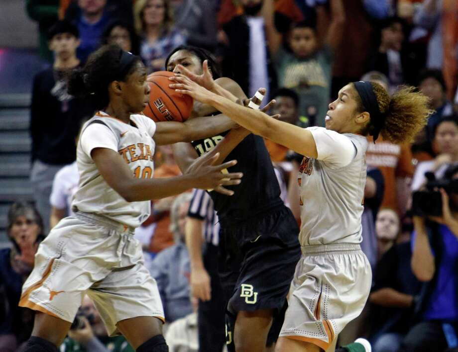 Baylor's Khadijiah Cave, center, fights for the loose ball with Texas' Lashann Higgs, left, and Celina Rodrigo, right, during the second half of an NCAA college basketball game, Sunday, Jan. 17, 2016, in Austin, Texas. Baylor won 80-67. (AP Photo/Michael Thomas) Photo: Michael Thomas, FRE / Associated Press / FR65778 AP