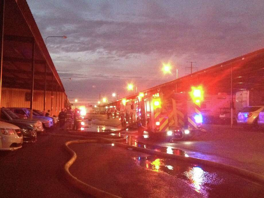 SAFD arson investigators probe cause of 2-alarm fire Sunday, Jan. 17, 2016.  A total of 24 units responded to the fire at a storage facility on the North East Side. Photo: By Alexa Tavarez, Express-News