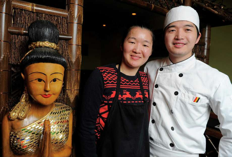 Xue Wu, owner of Ocha Thai and Japanese Cuisine in Stamford, Conn., talks candidly on Jan. 14, 2016 about her family and how they immigrated from China. She is photographed with her brother Hong Wu, who works as a Sushi Chef. Photo: Matthew Brown / Hearst Connecticut Media / Stamford Advocate