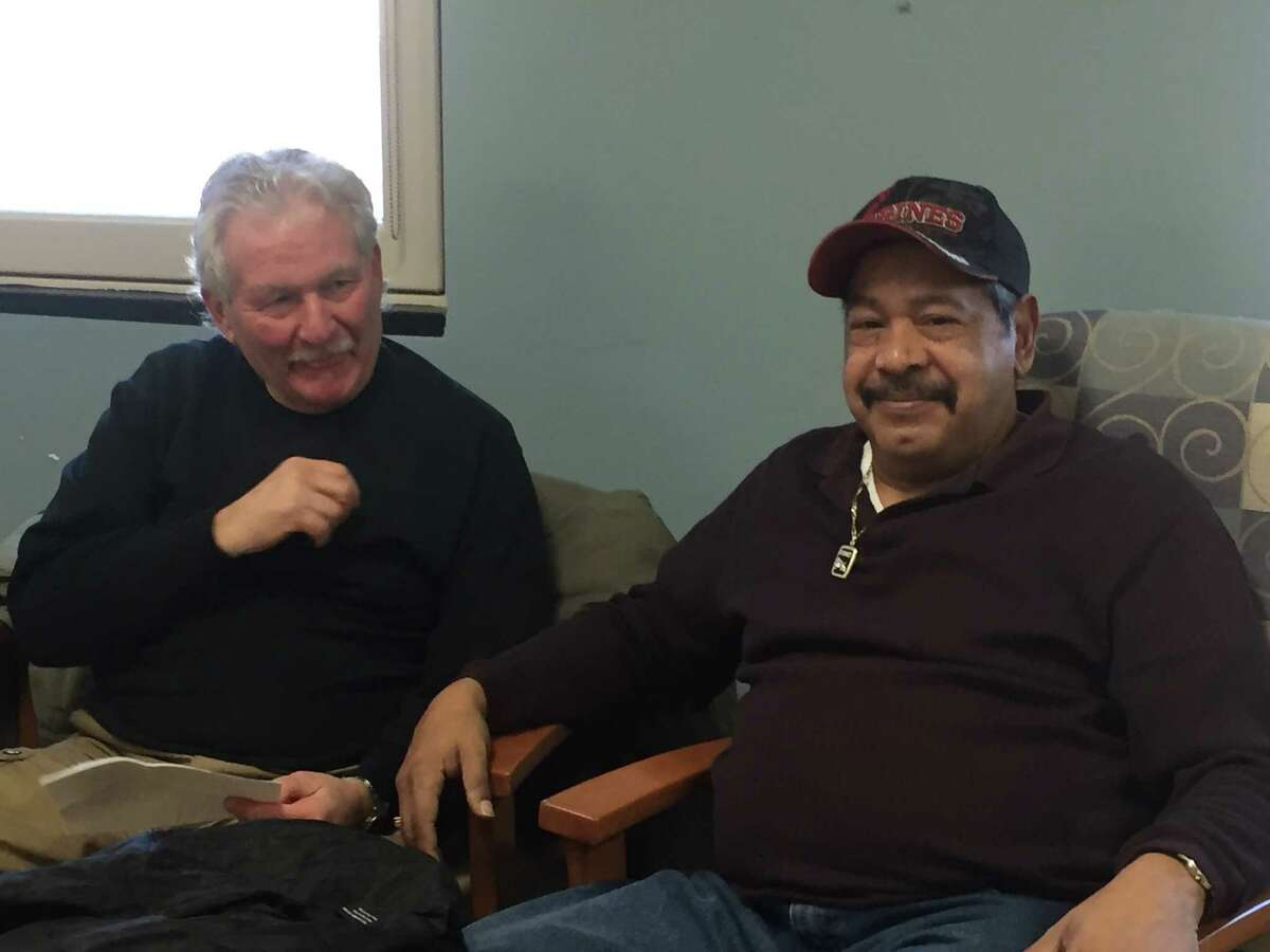 Peter Risatti, 70, of Lee, Mass., and Silvester Diaz, 69, of Troy, are part of a Vietnam veterans group unhappy about the discontinuation of their PTSD therapy. (Claire Hughes/Times Union)