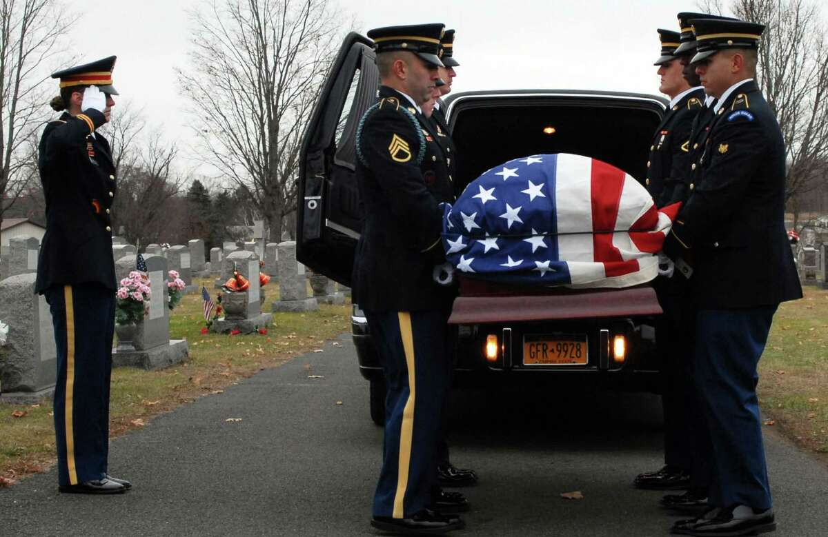 Soldiers of the New York Army National Guard's Honor Guard carry the casket of WWII veteran Leo P. Dean during Dean's funeral at St. Mary's Cemetery in Waterford, N.Y. on Dec. 17, 2015. (U.S. National Guard photo by Master Sgt. Raymond Drumsta/released)