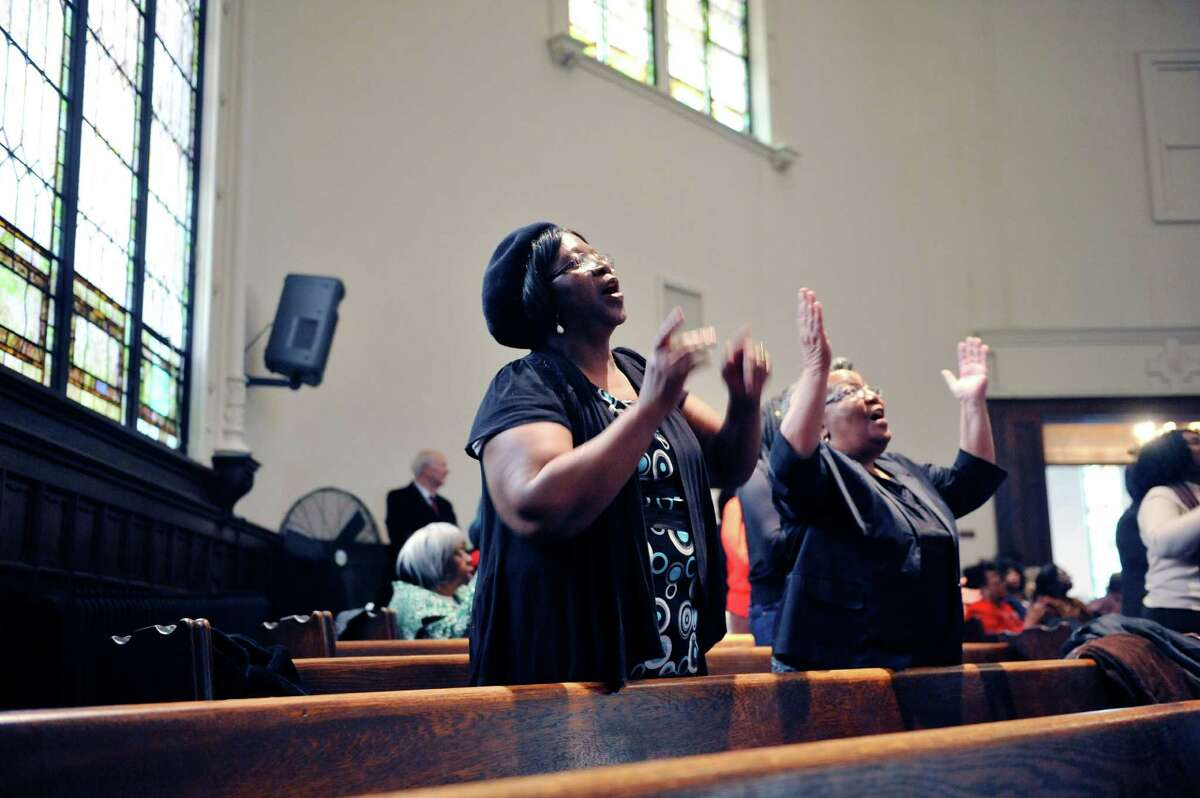 Mt. Olivet Baptist Church parishioner, Jackie Charleston, left, and Minister Patricia Johnson, both from Schenectady, stand up to sing at the Dr. Martin Luther King, Jr. celebration on Sunday, Jan. 17, 2016, at the Mt. Olivet Baptist Church in Schenectady, N.Y. The event was put on by the Martin Luther King, Jr. Coalition of the Schenectady County Human Rights Commission. (Paul Buckowski / Times Union)