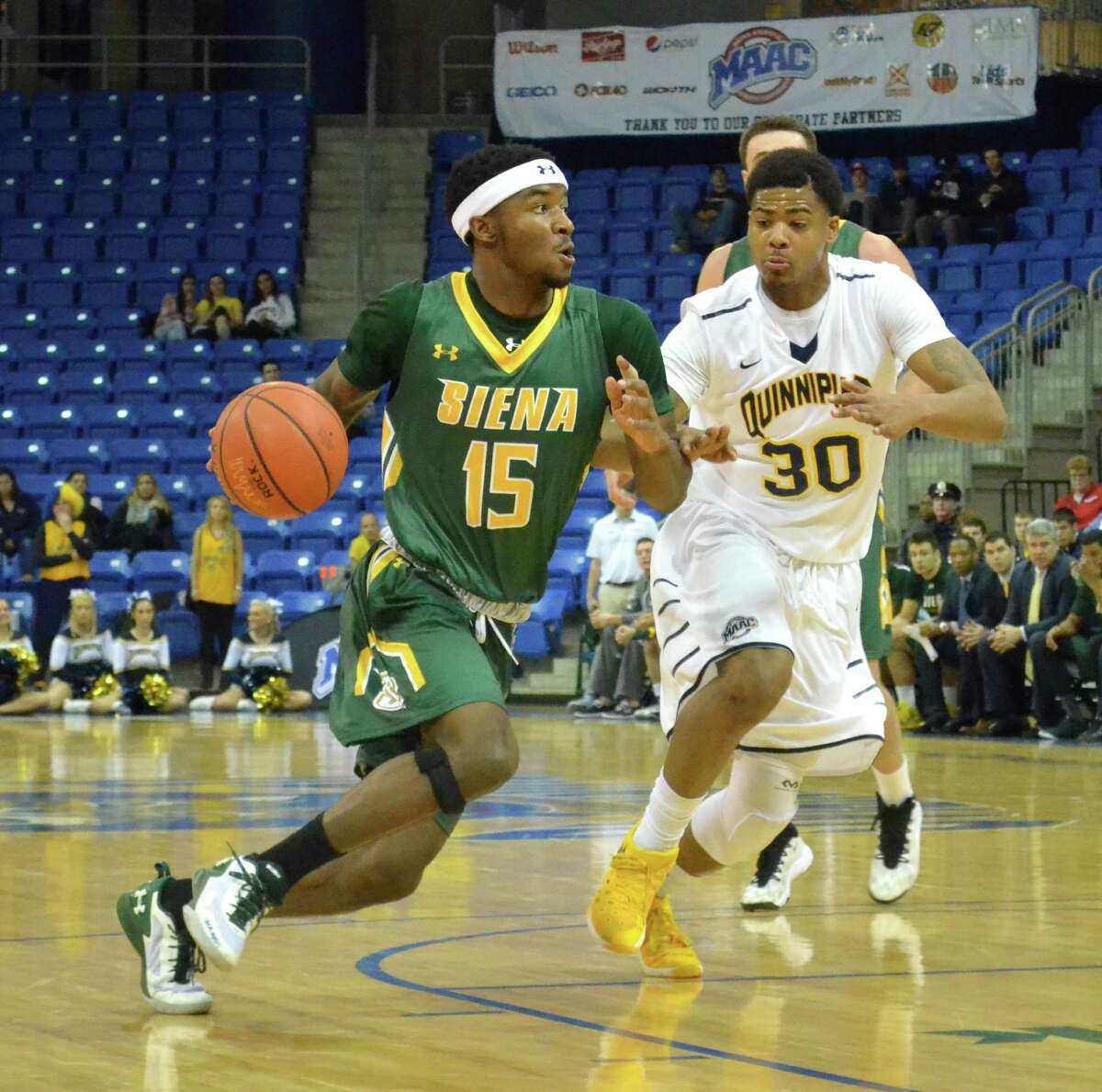 Siena's Nico Clareth drives to the hoop in the Saints' 64-52 win over Quinnipiac at the TD Bank Sports Center. (Nick Solari/Special to the Times Union)