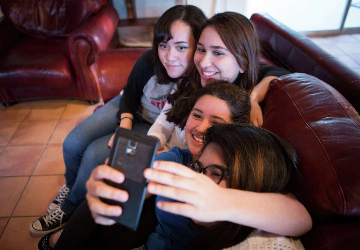 Chinquapin Prep School students snap a selfie in the residence where they live from Sunday to Friday as part of the school's pilot program for allowing girls to live on campus; a new dorm and dining hall will allow girls to join boys living at the 47-year-old boarding school. From left to right are Desiree Toutai, 16, Angelica Rodriguez, 16, Maria Renteria, 16, and Natalie Gutierrez, 17.