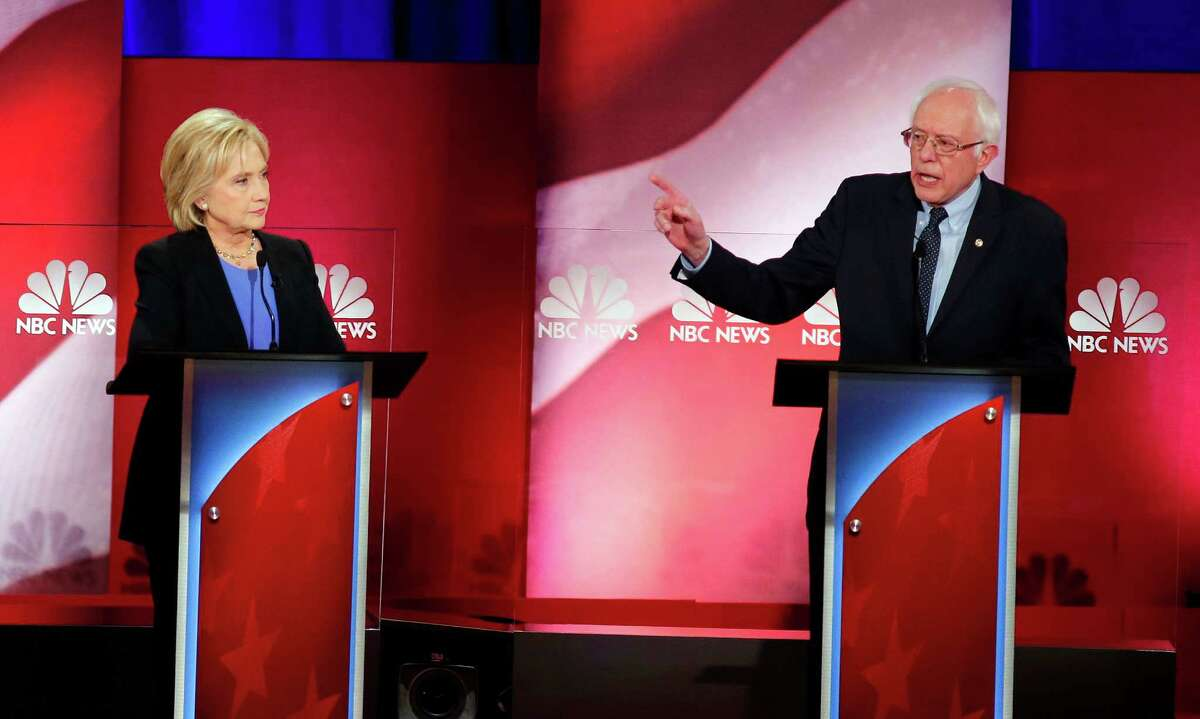 Democratic presidential candidate, Sen. Bernie Sanders, I-Vt., gestures towards Democratic presidential candidate, Hillary Clinton during the NBC, YouTube Democratic presidential debate at the Gaillard Center, Sunday, Jan. 17, 2016, in Charleston, S.C. (AP Photo/Mic Smith) ORG XMIT: SCML119