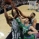 San Antonio Spurs' Kawhi Leonard (from left), Dallas Mavericks' Raymond Felton, Zaza Pachulia, and Tim Duncan grab for a rebound during first half action Sunday Jan. 17, 2016 at the AT&T Center. The Spurs won 112-83.