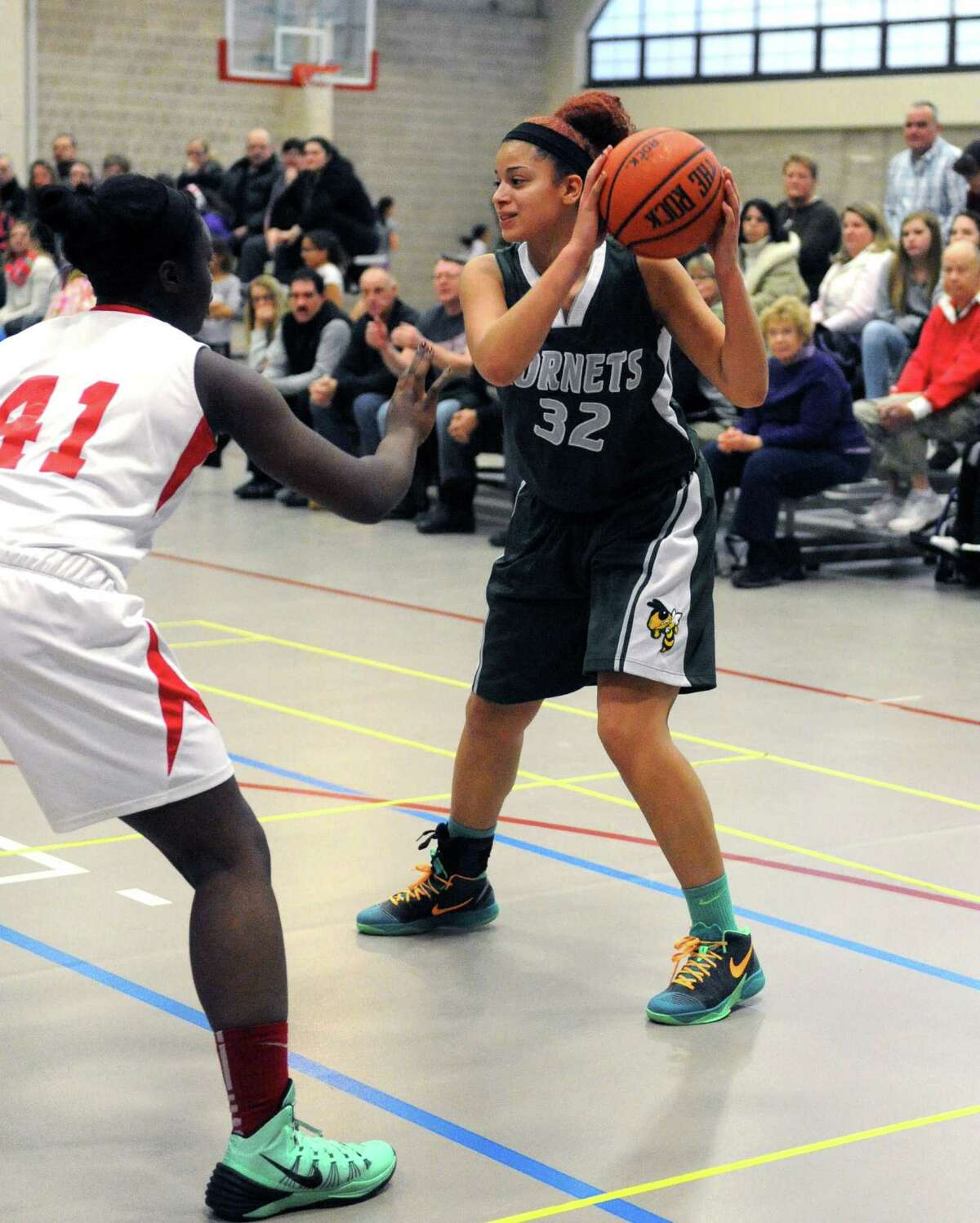 Heatly's Kyra Oeffler looks to pass during their high school basketball game against Emma Willard on Thursday Jan. 29, 2015 in Troy , N.Y. (Michael P. Farrell/Times Union)