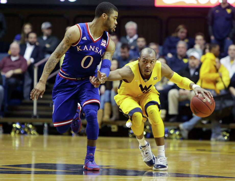 Four big upsetsNo. 11 West Virginia 74, No. 1 Kansas 63