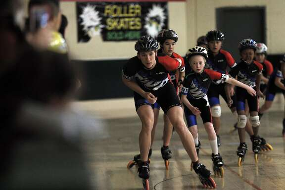 Speed skaters demonstrate their sport during an open house at Redwood Roller Rink in Redwood City, Calif., on Sunday, January 17, 2016.  The 60-year-old Redwood Roller Rink is the last roller rink in the peninsula, and the Peninsula Roller Girls hosted an open house to showcase the different skating events available at the business.