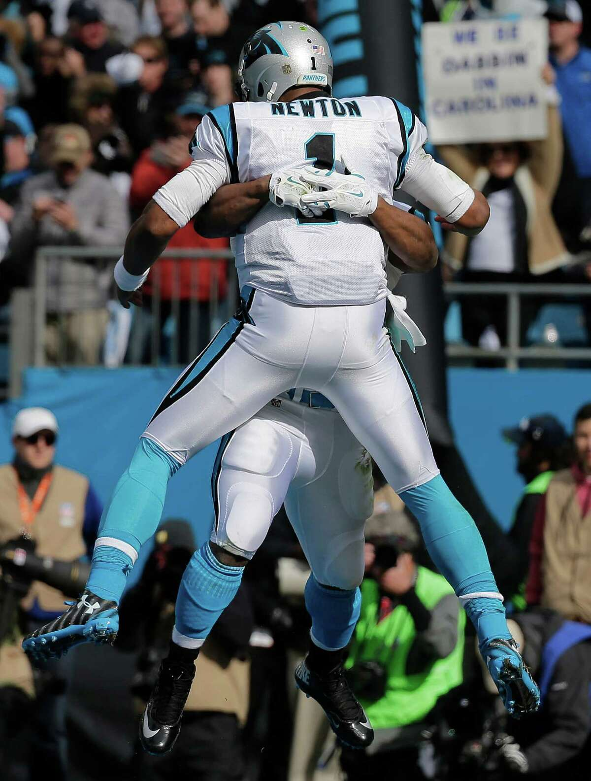 Carolina Panthers quarterback Cam Newton (1) celebrates with Carolina Panthers running back Jonathan Stewart (28) after Stewart scored a touchdown against the Seattle Seahawks during the first half of an NFL divisional playoff football game, Sunday, Jan. 17, 2016, in Charlotte, N.C. (AP Photo/Chuck Burton) ORG XMIT: NCMS104