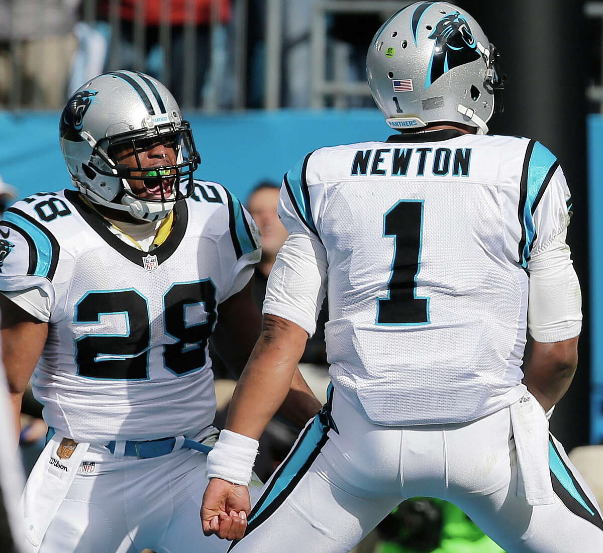 Carolina Panthers running back Jonathan Stewart (28) celebrates his touchdown with Carolina Panthers quarterback Cam Newton (1) against the Seattle Seahawks during the first half of an NFL divisional playoff football game, Sunday, Jan. 17, 2016, in Charlotte, N.C. (AP Photo/Chuck Burton) ORG XMIT: NCMS105
