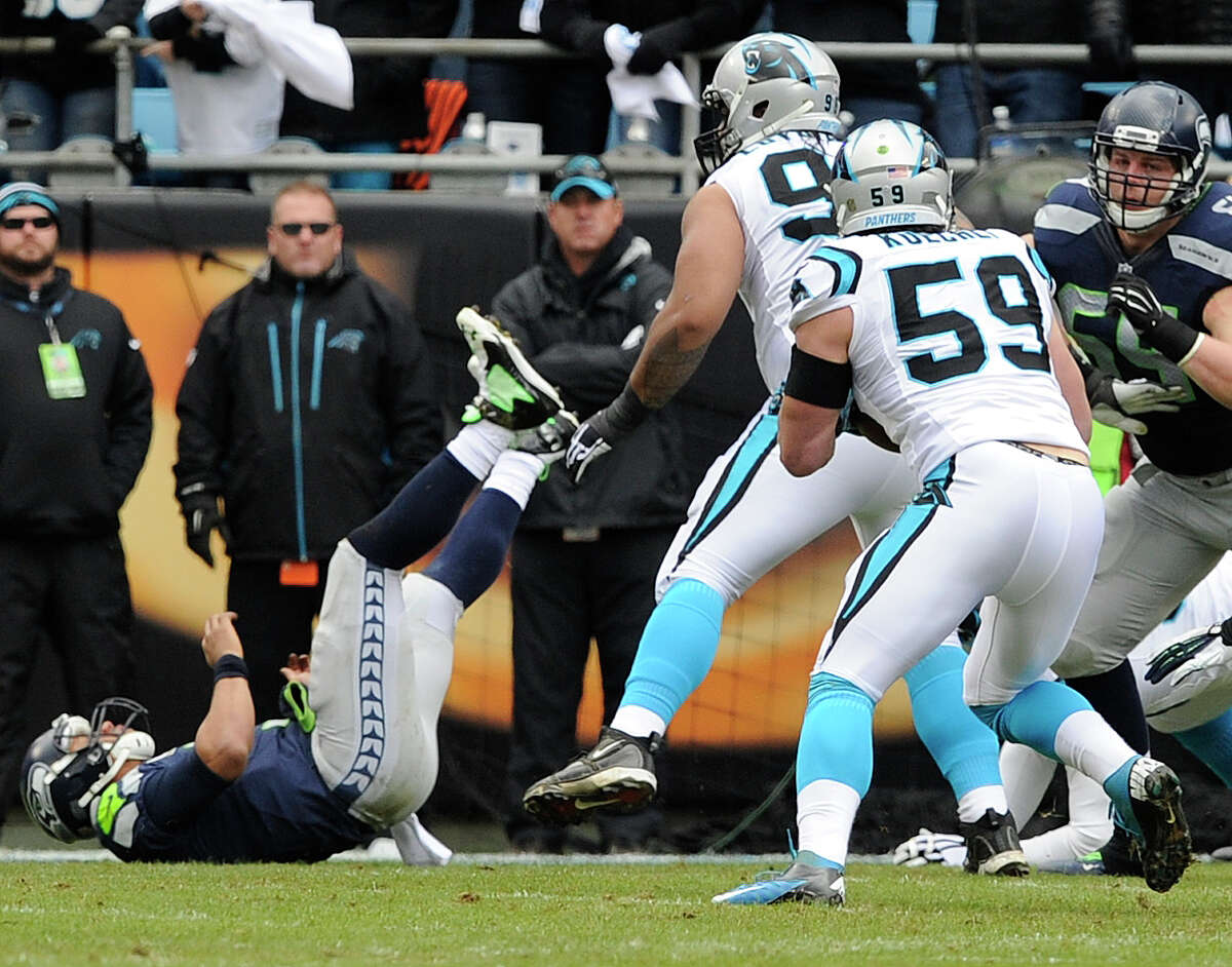 Carolina Panthers middle linebacker Luke Kuechly (59) intercepts a Seattle Seahawks quarterback Russell Wilson thrown ball during the first half of an NFL divisional playoff football game, Sunday, Jan. 17, 2016, in Charlotte, N.C. Kuechly scored a touchdown on the play. (AP Photo/Mike McCarn) ORG XMIT: NCMS107