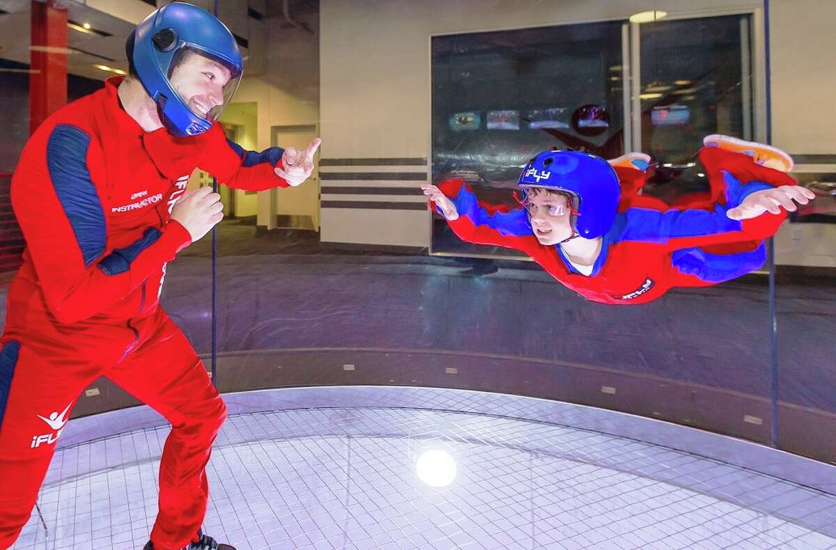 At iFly Indoor Skydiving, an instructor accompanies every flyer into the flight chamber to help them fly right and stay safe during your minute long flight