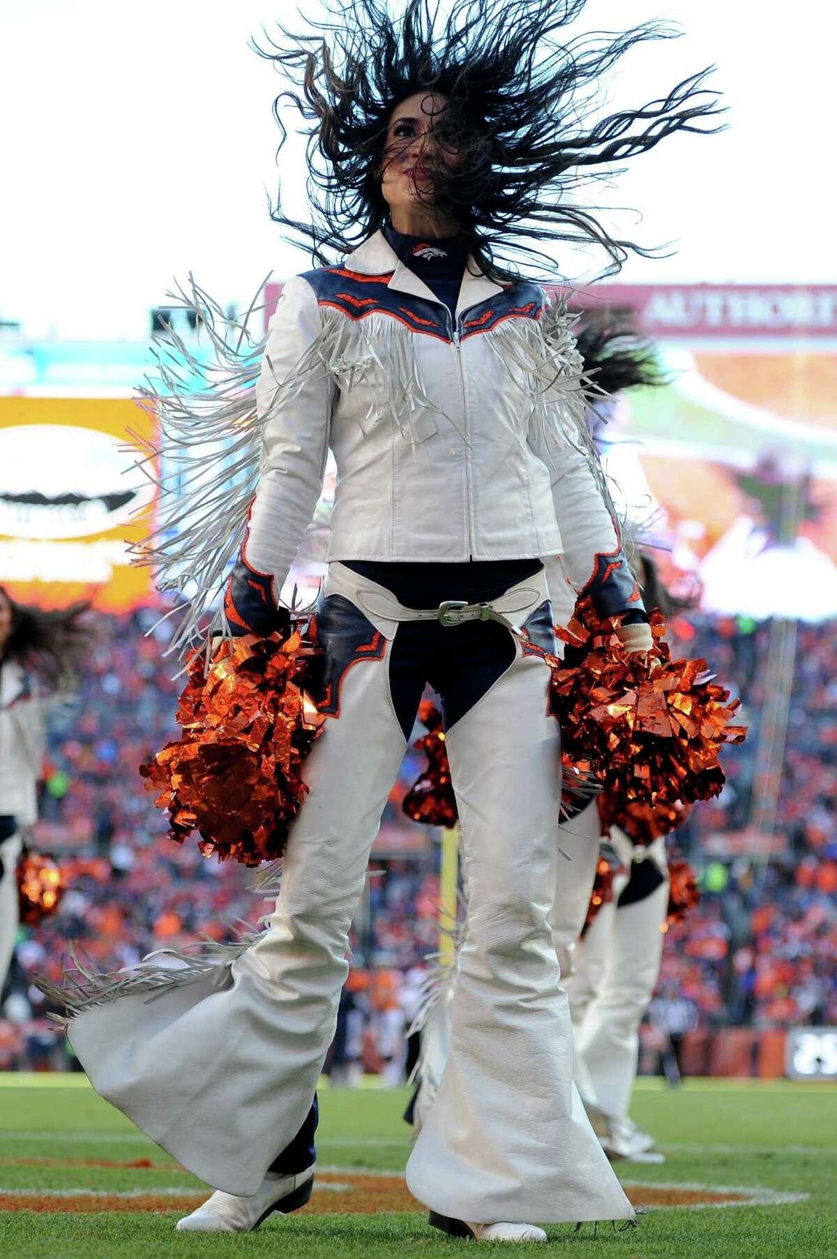 DENVER, CO - JANUARY 17: Denver Broncos cheerleaders perform in the first half during the AFC Divisional Playoff Game at Sports Authority Field at Mile High on January 17, 2016 in Denver, Colorado.