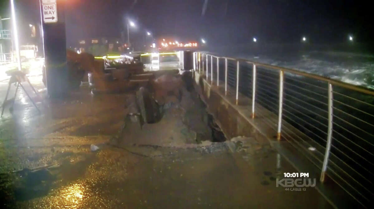 Waves pounded the shore and eroded the ground beneath of a stretch of sidewalk along Beach Boulevard in Pacifica, Calif. on Sunday Jan 17, 2016.