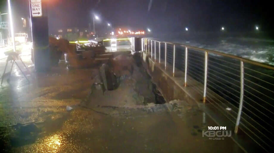 Waves pounded the shore and eroded the ground beneath of a stretch of sidewalk along Beach Boulevard in Pacifica, Calif. on Sunday Jan 17, 2016. Photo: CBS San Francisco