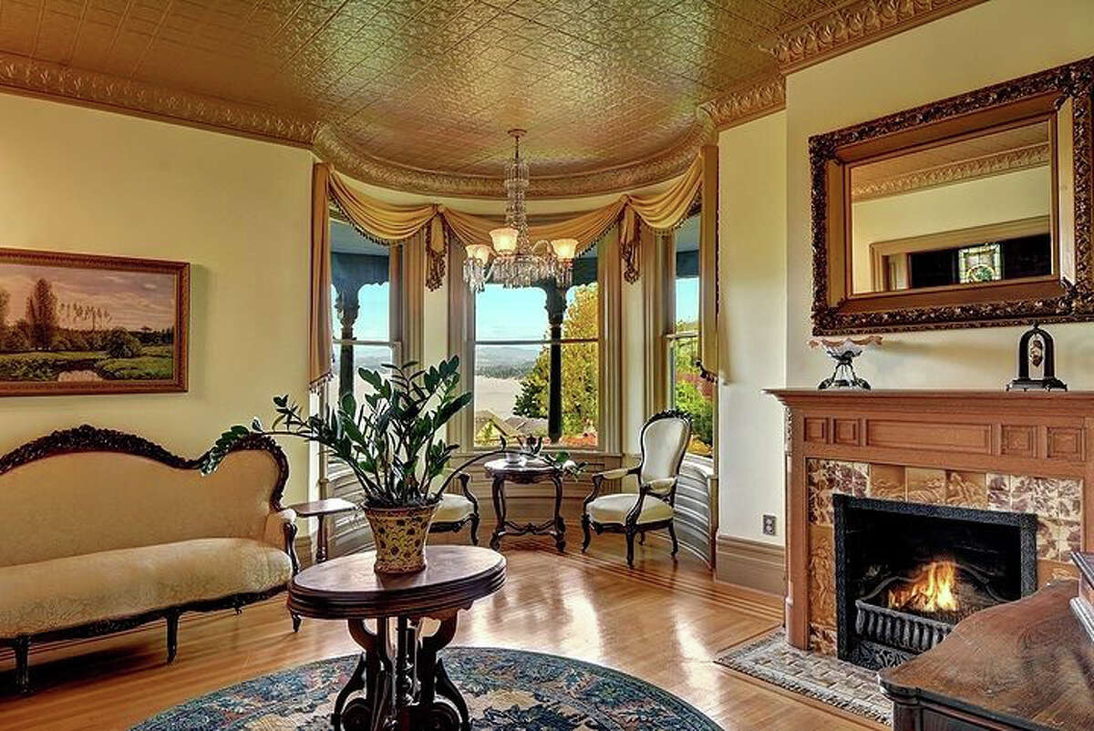 The house was built in 1892 but has been restored. This is the parlor, which features curved class looking out over the Cascades.