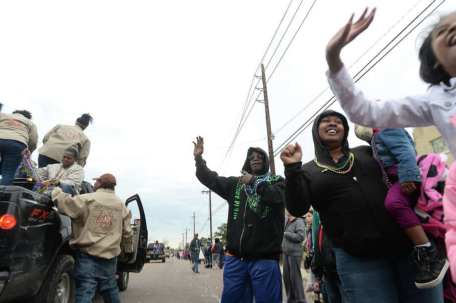 Families line Highland Avenue to take in the bands and floats celebrating the life of Dr. Martin Luther King, Jr., during the annual MLK Day Parade in Beaumont Saturday morning.  Photo taken Saturday, January 16, 2016  Kim Brent/The Enterprise Photo: Kim Brent / Beaumont Enterprise