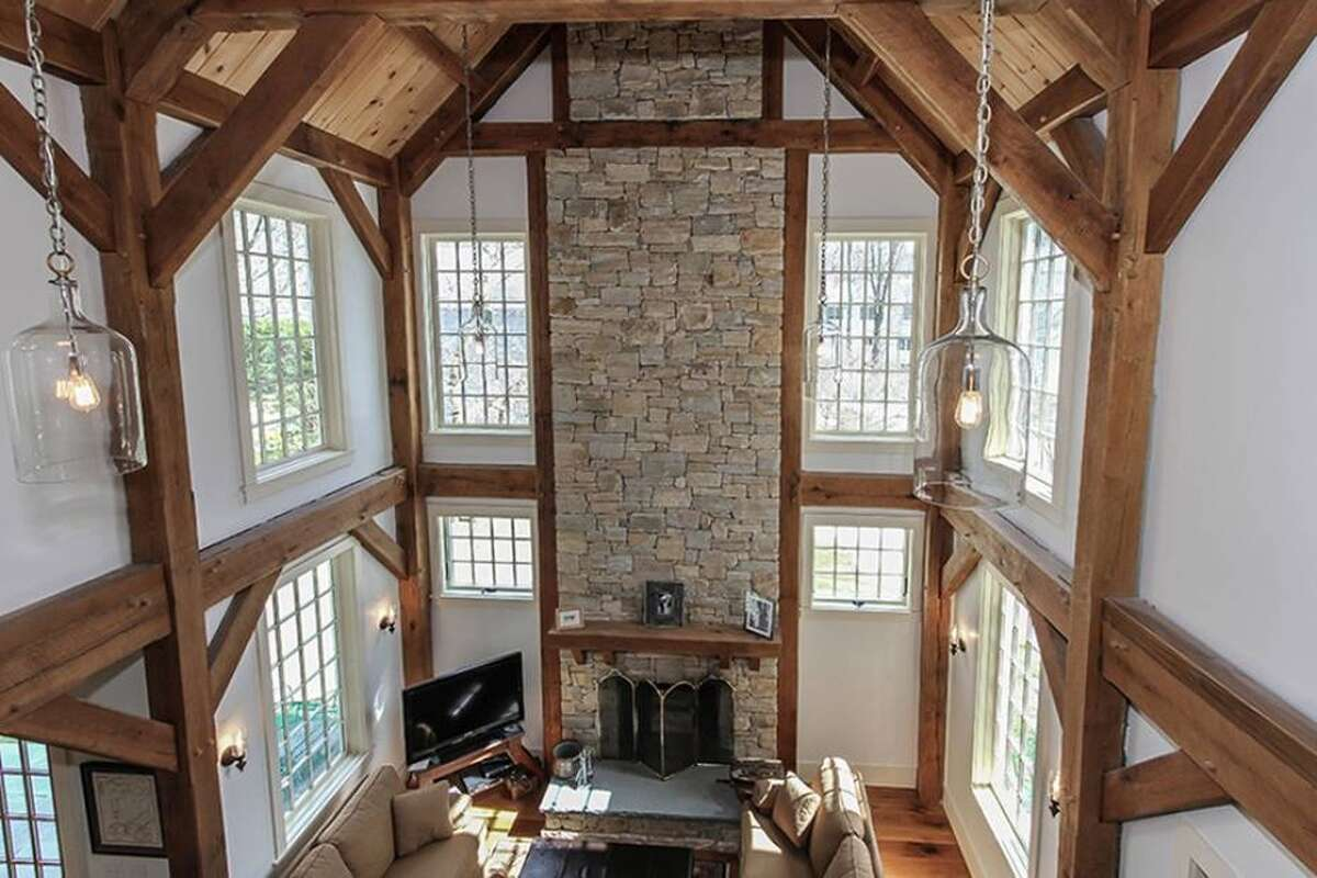 39 Midbrook Lane, Old Greenwich, CT Features: Two-story living room with a beamed cathedral ceiling, Stone fireplace, View of Laddins Rock Conservation ParkView full listing on Zillow