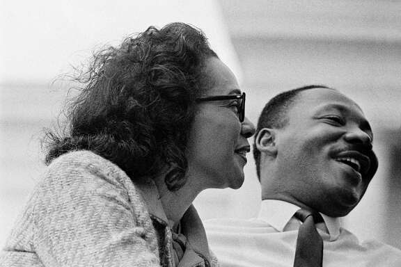 MONTGOMERY, AL - MARCH 25:  Coretta Scott King and husband civil rights leader Dr. Martin Luther King, Jr., on platform at end of 1965 Selma to Montgomery, Alabama Civil Rights March. On March 25, 1965 in Montgomery, Alabama. (Photo by Stephen F. Somerstein/Getty Images)