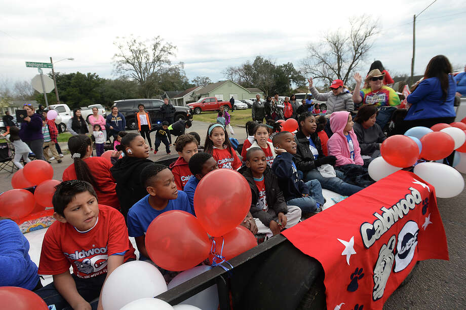 Families line Highland Avenue to take in the bands and floats celebrating the life of Dr. Martin Luther King, Jr., during the annual MLK Day Parade in Beaumont Saturday morning.