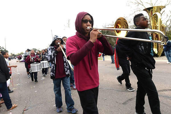 Families line Highland Avenue to take in the bands and floats celebrating the life of Dr. Martin Luther King, Jr., during the annual MLK Day Parade in Beaumont Saturday morning. Photo taken Saturday, January 16, 2016 Kim Brent/The Enterprise