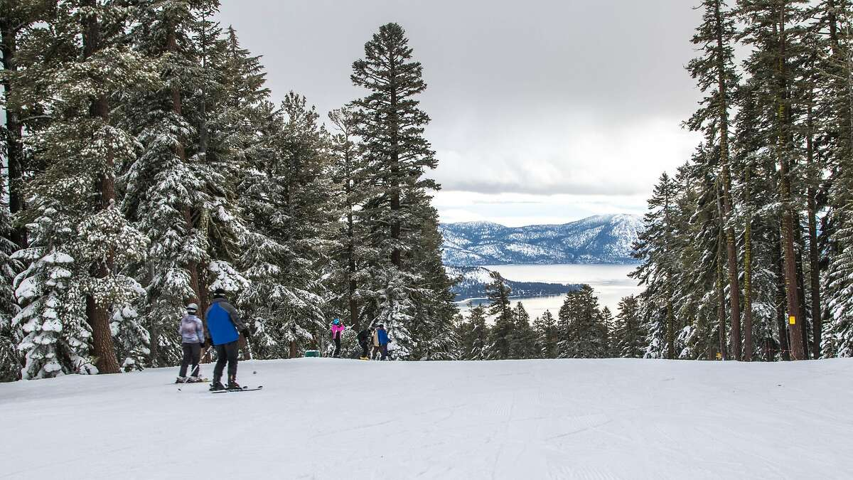 Skiers enjoy a break in the snowy weather at the Northstar Ski Resort on Lake Tahoe's north shore Sunday, Jan. 17, 2015.