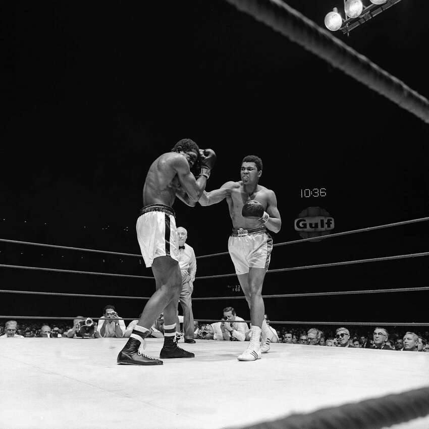 HOUSTON, TX - FEBRUARY 1967: Muhammad Ali fights Ernie Terrell at the Houston Astrodome on February 6, l967 in Houston, Texas. Ali defeated Terrell.