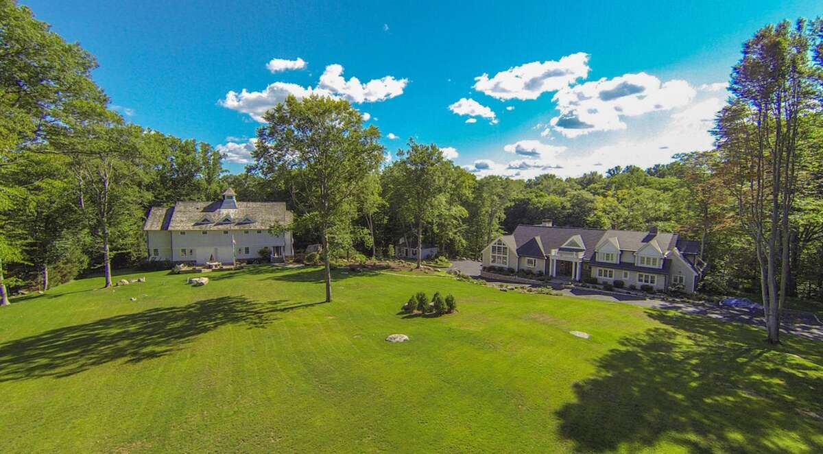 """A seven-bedroom party house in New Canaan with an asking price of $15,000,000 has been on the market since the end of January. The Home Builders & Remodelers Association of Connecticut-winning property features a separate """"sports"""" barn equipped with a golf simulator, basketball court, movie theater, and a game room that features billiards, pinball and a milk shake bar. Read more."""