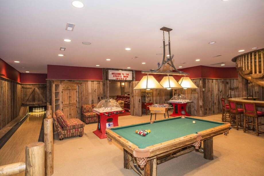 "Life can be all play and no work if you live in the house at 364 Laurel Rd, New Canaan. This seven-bedroom compound now on the market for $12,000,000 comes with a separate ""sports barn"" dedicated solely to having fun.