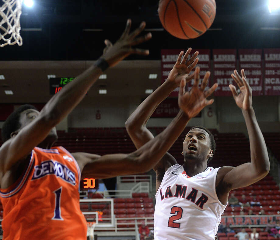 Lamar's Dorian Chatman puts up his shot against the pressure of Northwestern State's Levy Yancy during Saturday's match-up at the Montagne Center.  Photo taken Saturday, January 16, 2016  Kim Brent/The Enterprise Photo: Kim Brent / Beaumont Enterprise