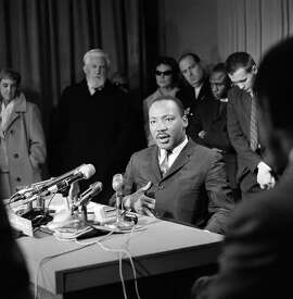 """Dr. Martin Luther King speaks from San Francisco on March 28, 1965 on a television program originating in Washington (""""Meet the Press"""") and announced him intention of asking an economic boycott on goods made in Alabama. King spoke to an overflow crowd in Grace Cathedral atop Nob Hill in San Francisco. (AP Photo)"""
