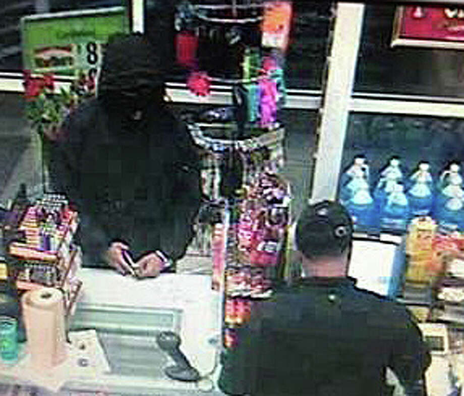 This surveillance camera image of one of the two armed men suspected of robbing the Cumberland Farms store on Kings Highway East early Monday was released by police. Photo: Fairfield Police Department / Fairfield Police Department / Fairfield Citizen