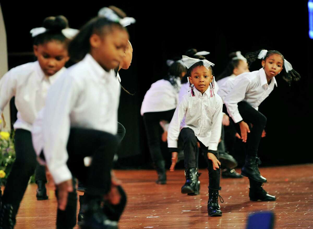 Members of Minnie Tone Setters Step Team perform during the New York State Dr. Martin Luther King Jr. 87th Birthday Memorial Observance at the Empire State Plaza on Monday, Jan. 18, 2016, in Albany, N.Y. (Paul Buckowski / Times Union)