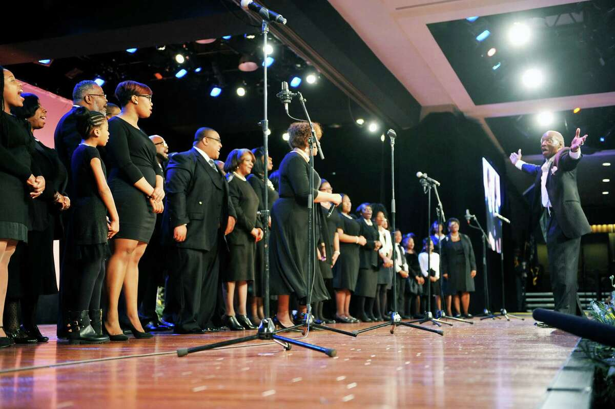 The Capital District Community Voices of Praise choir performs during the New York State Dr. Martin Luther King Jr. 87th Birthday Memorial Observance at the Empire State Plaza on Monday, Jan. 18, 2016, in Albany, N.Y. (Paul Buckowski / Times Union)