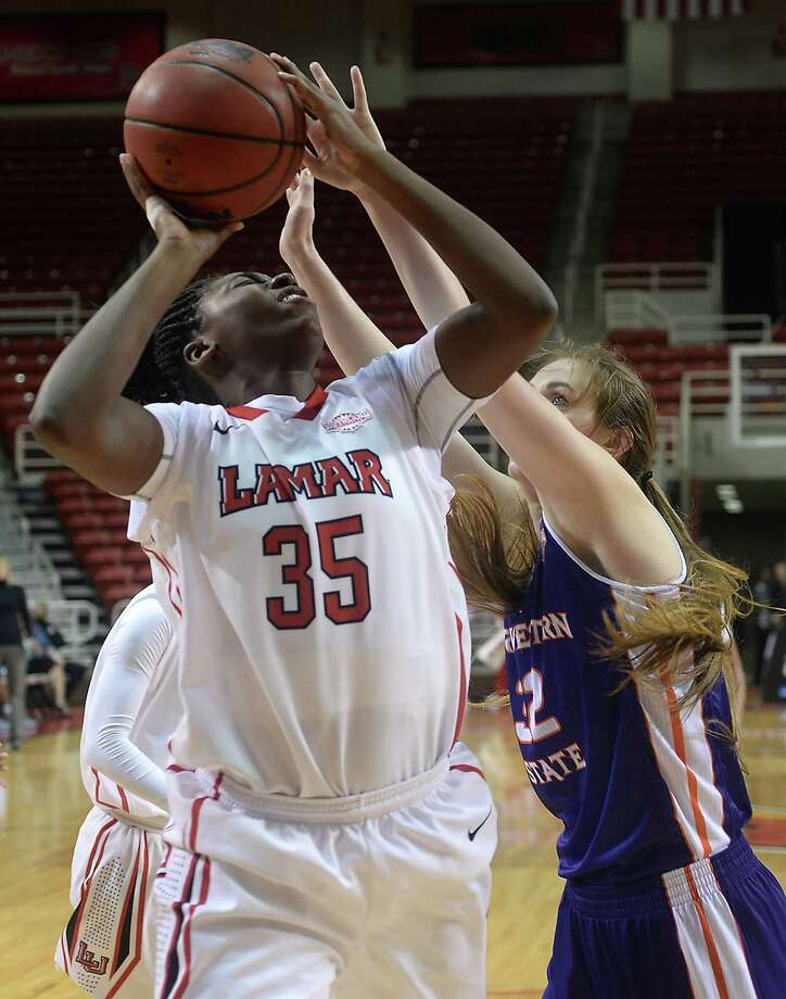 Lamar's Laka Blache puts up her shot against the pressure of Northwestern State's Cheyenne Brown during Saturday's match-up at the Montagne Center. Photo taken Saturday, January 16, 2016 Kim Brent/The Enterprise Photo: Kim Brent / Beaumont Enterprise
