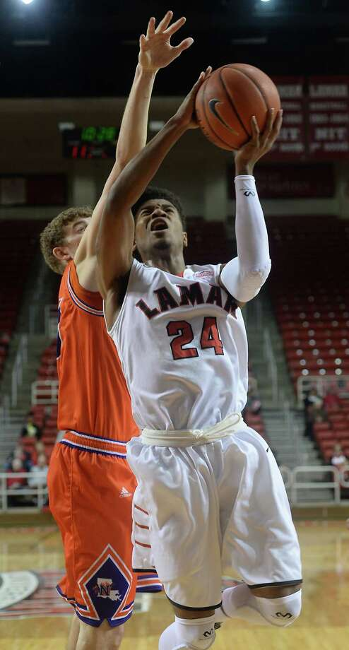 Lamar's Quan Jones shoots against the defensive efforts of Northwestern State's Matt Killian during Saturday's match-up at the Montagne Center. Photo taken Saturday, January 16, 2016 Kim Brent/The Enterprise Photo: Kim Brent / Beaumont Enterprise