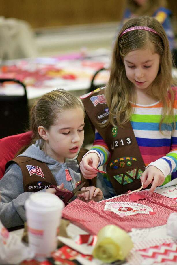 Colleen Shields and Madison Rivera, both age 8, from Brownie Troop 40213 work together to create a Valentine for the veterans at Rocky Hill Veterans Hospital.  The Roger Sherman Chapter of Daughters of the American Revolution and VFW Post 1672 Ladies Auxiliary co-sponsored the event at the VFW Post 1672 in New Milford, CT. Photo: Trish Haldin / For Hearst Connecticut Media / The News-Times Freelance