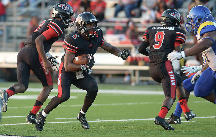 Port Arthur Memorial's Kameron Martin picks up yardage against Ozen during their Friday night match-up at Memorial Stadium in Port Arthur.