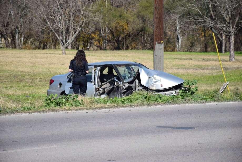 San Antonio emergency crews investigate the scene of a crash in the 6300 block of Enrique M. Barrera Parkway, formerly Old Highway 90, on Jan. 18. 2016. Photo: Mark D. Wilson/San Antonio Express-News