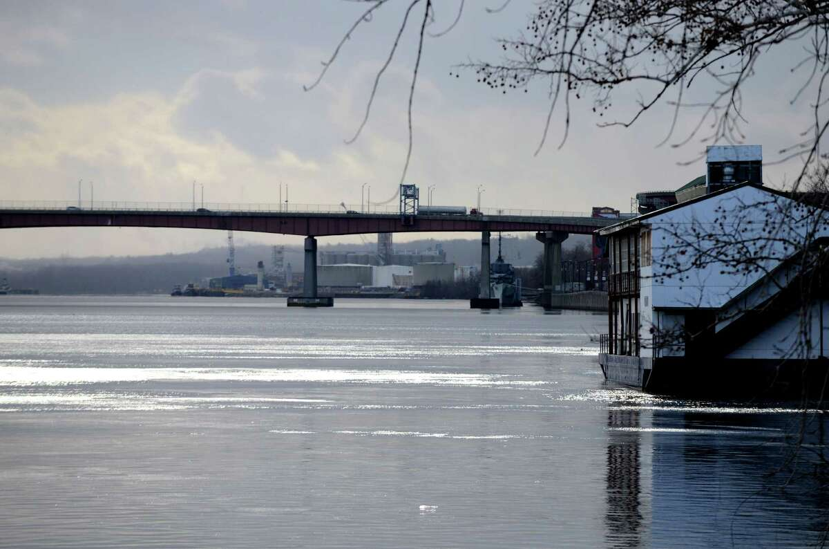 Sunlight glistens off the Hudson River at Jennings Landing Monday afternoon, Jan. 18, 2016, in Albany, N.Y. Dunn Memorial Bridge and the Port of Albany are visible in the background. (Will Waldron/Times Union)
