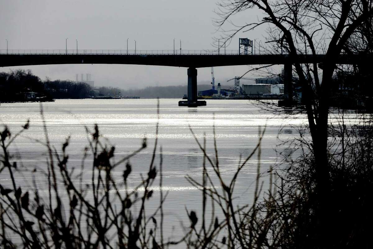 Sunlight glistens off the Hudson River at Jennings Landing Monday afternoon, Jan. 18, 2016, in Albany, N.Y. Dunn Memorial Bridge and the Port of Albany, right, are visible in the background. (Will Waldron/Times Union)